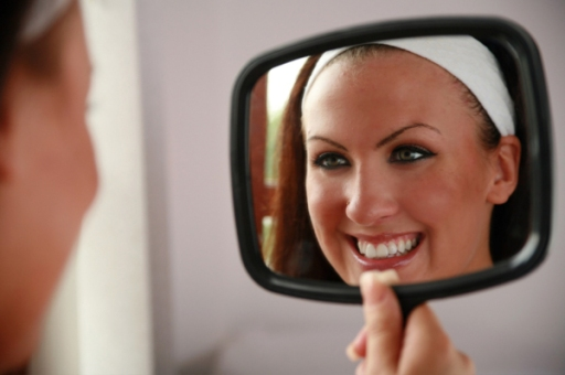 woman-looking-at-teeth-in-mirror.jpg